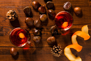 Alcoholic punch drink, chestnuts and pine cone