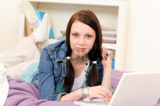 Young student girl home study with laptop