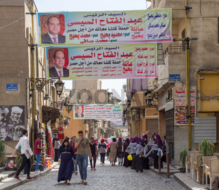 Banners supporting current Egyptian president Abdel-Fattah El-Sisi for a second term for the presidential elections at crowded Al Moez Street, Gamalia district, Cairo, Egypt