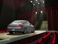 Sedan car on a fashion runway, in the spotlght.