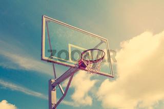 Basketball hoop against sky background