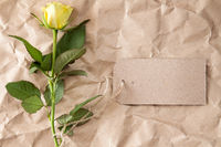 Single yellow rose with blank tag