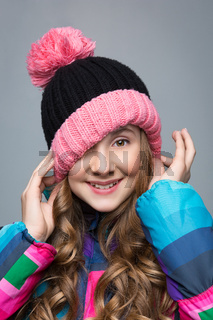 Beautiful girl in wool hat