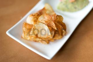 White bowl Potato chips.
