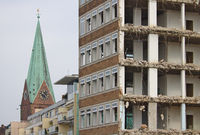 Demolished building and church tower