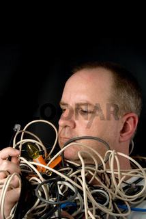 Man Tangled in Wires