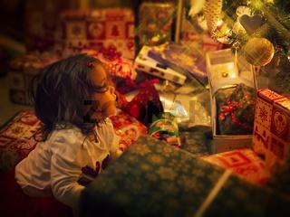 Baby staring at the Christmas tree