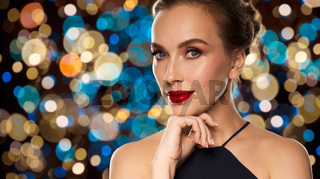 beautiful woman in black over lights background