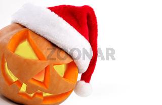Halloween pumpkin shiny inside wearing christmas hat on white