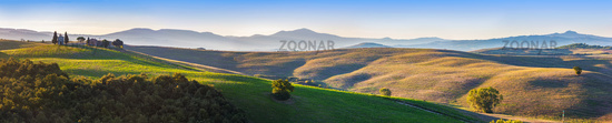 Tuscany landscape panorama at sunrise with a chapel of Madonna di Vitaleta, Italy.