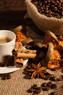 Close-up of coffee cup with cinnamon and star anise