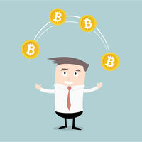 Businessman juggling Bitcoins