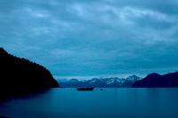 Boat Floating on Ocean Landscape with Blue Midnight Alaskan Light