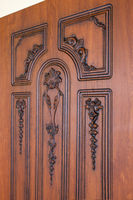 fragment carved brown wooden door