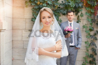 The bride and groom for a walk