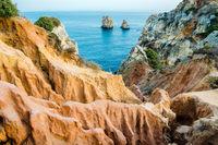 Unique red rocky landscape Lagos, Algarve, Portugal.