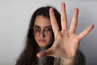 Abused woman stretching out her spread hand