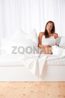 White lounge - Brown hair woman sitting on white sofa
