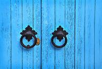 Blue wooden door with round handles