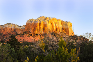 Setting Sun hits the side of a hill in Ghost Ranch of rural New Mexico, USA.