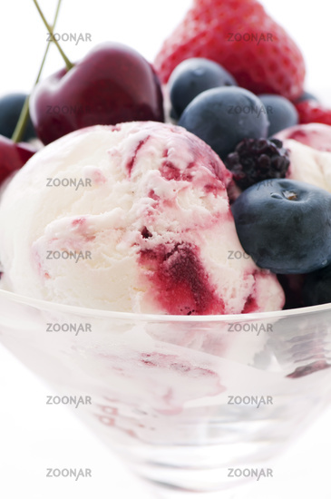 Scoop of ice cream with fresh fruits as closeup