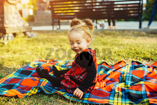 Smiling girl on the meadow