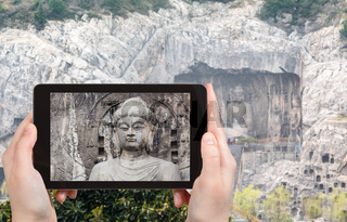 tourist photographs The Big Vairocana statue