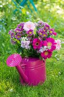 Pink flower bouquet in a watering can