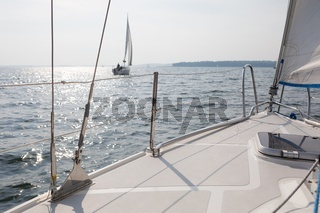 Landscape with yacht on lake and blue sky. Tranquil lake scene.