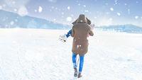 Mann trägt Kind im Schnee im Winter