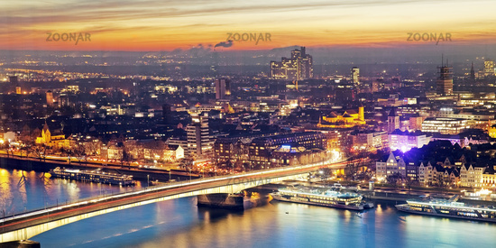 cityscape of Cologne with Deutzer brigde over Rhine at sunset, Cologne, Germany, Europe