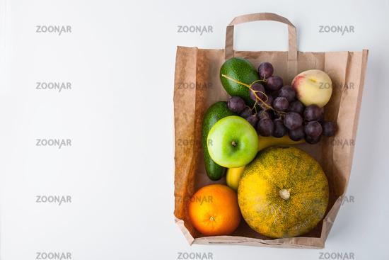 Assorted fruit inside a paper bag