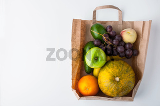 Assorted fruit inside a paper bag