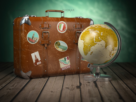 Old suitcase with globe on wood  background. Travel or tourism concept.