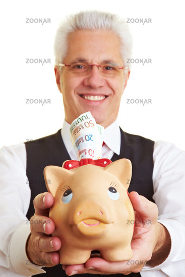 Pensioner with piggy bank