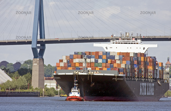 Container ship with tugboat in Hamburg port, Germa