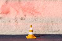 a traffic cone on a wall