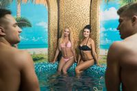 Happy young couples in swimming pool in sauna