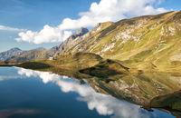 sky reflected in alpine lake