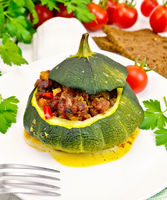Squash green stuffed with meat on light board