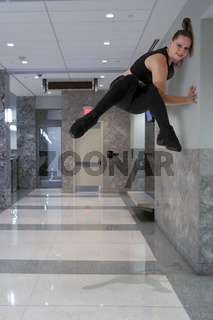 Woman Doing Parkour indoors