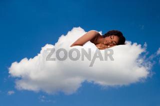 Beautiful woman deeply asleep and dreaming on Cloud nine