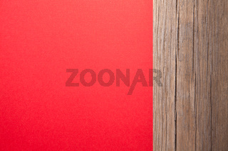 Christmas card, red taxtured paper on wooden background