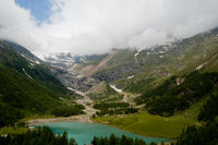 Beautiful pond in the mountains along the way of the red train of bernina