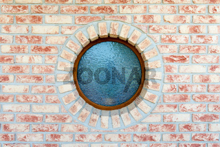 Round window on brick wall