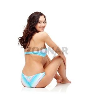 happy young woman sunbathing in bikini swimsuit