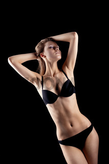 Young blond girl in black lingerie