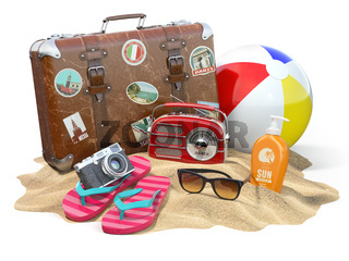 Beach accessories for relaxing. Sunscreen bottle, flip flops, sunglasses, radio camera and ball on the sand.
