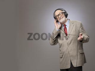 Senior man in headphones