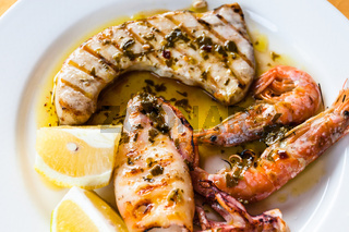 sicilian grilled fish and seafood mix close up